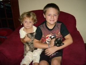 Susanne and Charlie with their newly adopted kittens, Cheetah and Whiskers.